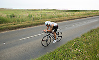 27 JUL 2013 - CROMER, GBR - John Jacobs makes his way along the coast road past the salt marshes at Salthouse, North Norfolk, Great Britain during The Anglian Triathlon (PHOTO COPYRIGHT © 2013 NIGEL FARROW, ALL RIGHTS RESERVED)