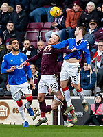 26th January 2020, Tynecastle Park, Edinburgh, Scotland; Scottish Premier League football, Hearts of Midlothian versus Rangers; Liam Boyce of Hearts and Jon Flanagan of Rangers jump for the cross