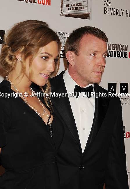 BEVERLY HILLS, CA - OCTOBER 14: Jacqui Ainsley and Guy Ritchie  arrive at the The 25th American Cinematheque Award Honoring Robert Downey Jr. at The Beverly Hilton hotel on October 14, 2011 in Beverly Hills, California.