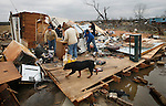 Family and friends sort through the remains of the Veverka household in Atkins, Ark. Wednesday, Feb 06, 2008 after being destroyed by a tornado Tuesday night. No one was injured in the Veverka home.