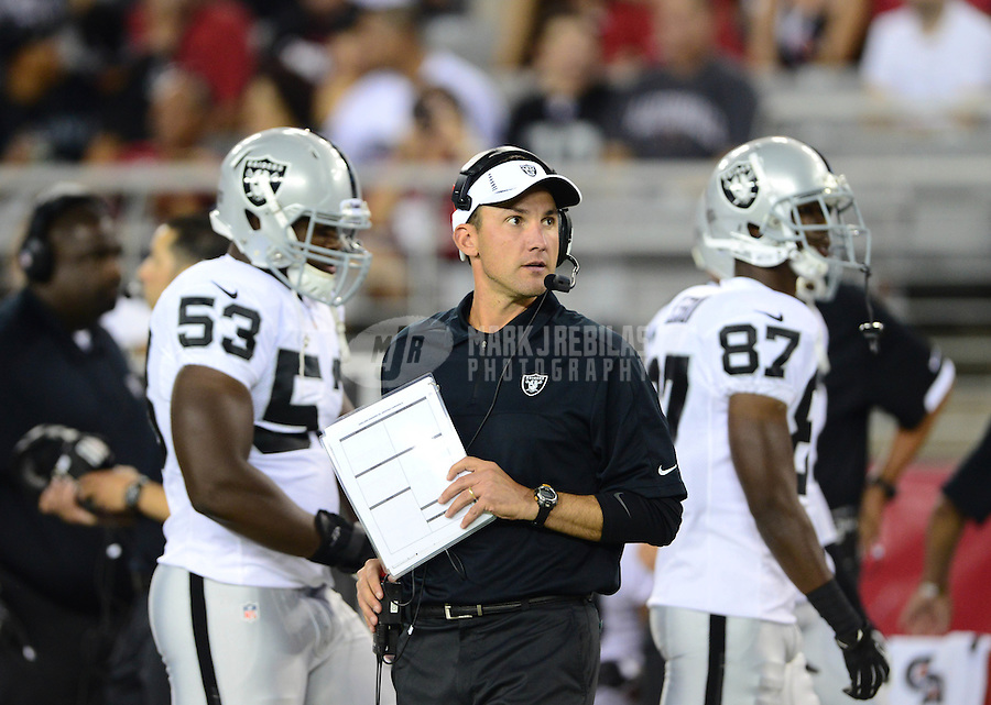 Aug. 17, 2012; Glendale, AZ, USA; Oakland Raiders head coach Dennis Allen against the Arizona Cardinals during a preseason game at University of Phoenix Stadium. The Cardinals defeated the Raiders 31-27. Mandatory Credit: Mark J. Rebilas-