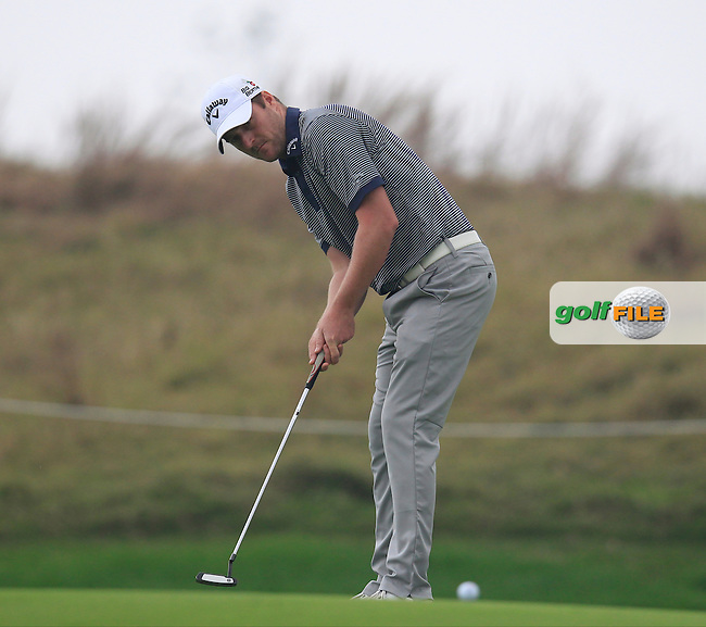 Marc Warren (SCO) putts on the 5th green during Saturay's Round 3 of the 2014 BMW Masters held at Lake Malaren, Shanghai, China. 1st November 2014.<br /> Picture: Eoin Clarke www.golffile.ie