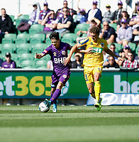 3rd November 2019; HBF Park, Perth, Western Australia, Australia; A League Football, Perth Glory versus Central Coast Mariners; Kim Soo-Beom of Perth Glory passes the ball as Gianni Stensness of the Central Coast Mariners moves in to tackle - Editorial Use