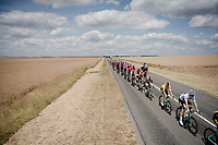 the peloton train rolling through the open fields with white jersey / best young rider Wout van Aert (BEL/Jumbo - Visma) escorting teammate / yellow jersey / GC leader Mike Teunissen (NED/Jumbo-Visma)<br /> <br /> Stage 3: Binche (BEL) to Épernay (FRA) (214km)<br /> 106th Tour de France 2019 (2.UWT)<br /> <br /> ©kramon