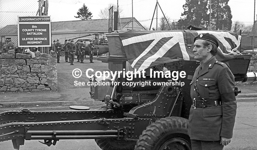 The coffin of Cormac McCabe, a UDR Captain,  who was kidnapped and murdered by the Provisional IRA, is conveyed by a gun carriage passed the UDR base where Mr McCabe was commanding officer. The funeral took place in his home town of Aughnacloy, Co Tyrone on 22nd January 1974. Mr McCabe's body was found a short distance inside N Ireland on the Tyrone-Monaghan border near Clogher. Mr McCabe, was the headmaster of a local school and a close friend of Ulster Unionist Westminister MP, Ken Maginnis. Mr McCabe was kidnapped by the Provisional IRA from a hotel in Monaghan town where he was having lunch with his wife and family. Mr McCabe was kidnapped on Saturday, 19th January 1971, his body was recovered on Sunday 20th January and his funeral was on 22nd January 1974. 197401200026d.<br />