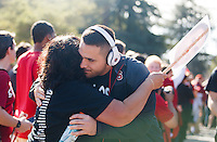 """Stanford- November 15, 2014:  David Parry gets a hug from his momb during """"The Walk"""" before the  Stanford vs Utah game Saturday afternoon at Stanford Stadium.<br /> <br /> Utah won 20-17."""