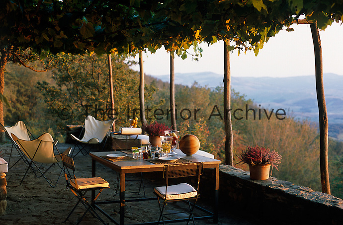 The vine covered terrace is a perfect place to sit and contemplate the spectacular views over the Tuscan landscape