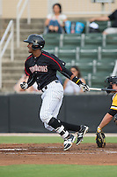 Louis Silverio (25) of the Kannapolis Intimidators follows through on his swing against the West Virginia Power at Intimidators Stadium on July 2, 2015 in Kannapolis, North Carolina.  The Power defeated the Intimidators 5-1.  (Brian Westerholt/Four Seam Images)