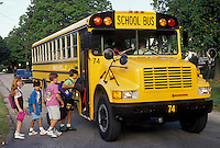 AJ2956, school bus, bus, Pennsylvania, Children boarding a yellow school bus going to school in the village of Exton in the state of Pennsylvania.