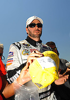 Apr 25, 2009; Talladega, AL, USA; NASCAR Sprint Cup Series driver Jimmie Johnson signs autographs during qualifying for the Aarons 499 at Talladega Superspeedway. Mandatory Credit: Mark J. Rebilas-
