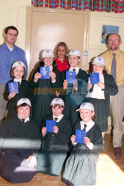 Pupils from 4th class Scoil Aonghusa who are starting to save in the Credit Union for an exchange trip to Wales. Pictured are students Kate Tiernan, Ashling Fay, Sophie Walker, Ciara Burke, Blaithin Seery, Anna Connor, Liadan Holohan, teachers Oilibhear O Braonain and Sean English and Carol O'Brien from Drogheda Credit Union..Picture: Paul Mohan/Newsfile