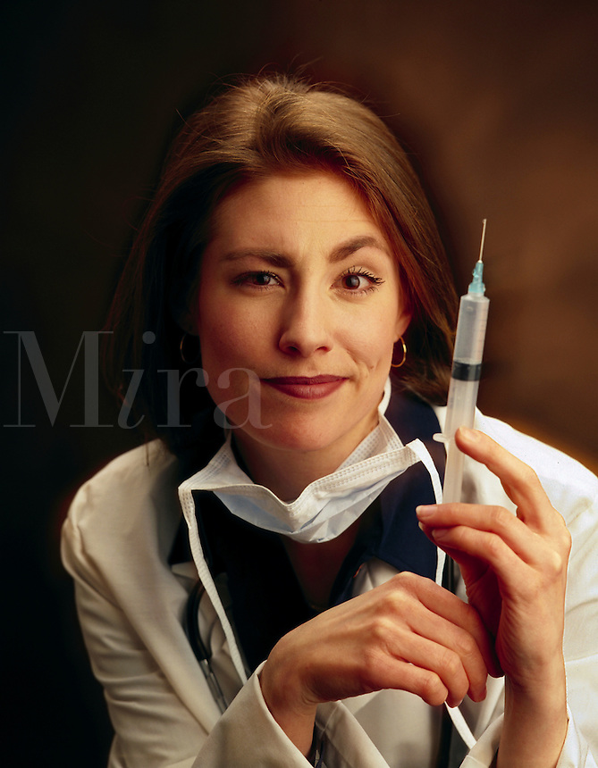 medical nurse with a large hypodermic needle. Medicine, humor, expressions, woman, women, female, injection.