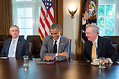 United States President Barack Obama, center, laughs as he talks to U.S. Senate Republican Leader Mitch McConnell (Republican of Kentucky), right, during a meeting with Members of Congress on foreign policy including U.S. Senate Majority Leader Harry Reid (Democrat of Nevada), left, in Cabinet Room of the White House in Washington, D.C., U.S., on Thursday, July 31, 2014. The U.S. might move to limit derivatives trading and short-term loans with Russian companies if sanctions already imposed fail to sway President Vladimir Putin to end support for rebels in eastern Ukraine. <br /> Credit: Andrew Harrer / Pool via CNP