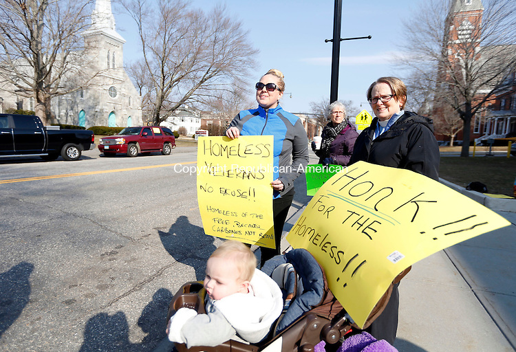 """Torrington, CT- 08 March 2016-030816CM03-  Reverend Ann Johnson, right, of Trinity Episcopal Church rallies with Janet Trujillo and her daughter, Cambria 1 years old, both of Torrington outside of City Hall in Torrington on Tuesday.  A rally was held following the city's removal of a vacant homeless encampment called, """"Tent City"""".   Platt said she is homeless and is currently staying at FISH.  Christopher Massa Republican-American"""