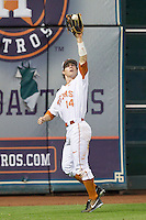 Texas Longhorns left fielder Ben Johnson #14 catches a fly ball against the Rice Owls at Minute Maid Park on February 28, 2014 in Houston, Texas.  The Longhorns defeated the Owls 2-0.  (Brian Westerholt/Four Seam Images)