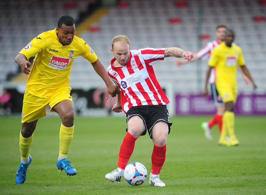 Lincoln City's Bradley Wood vies for possession with Woking's Kieran Murtagh<br /> <br /> Photographer Andrew Vaughan/CameraSport<br /> <br /> Football - Vanarama National League - Lincoln City v Woking - Saturday 23rd April 2016 - Sincil Bank - Lincoln <br /> <br /> &copy; CameraSport - 43 Linden Ave. Countesthorpe. Leicester. England. LE8 5PG - Tel: +44 (0) 116 277 4147 - admin@camerasport.com - www.camerasport.com