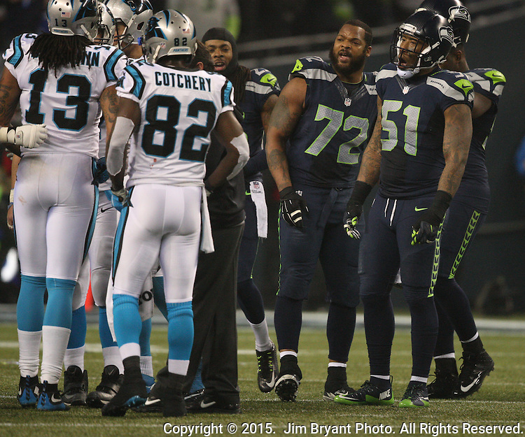 Seattle Seahawks Richard Sherman (25), Michael Bennett (72) and Bruce Irvin (51) jokes with the Carolina Panthers during a time out in the NFC Western Division Playoffs at CenturyLink Field  on January 10, 2015 in Seattle, Washington. The Seahawks beat the Panthers 31-17. ©2015. Jim Bryant Photo. All Rights Reserved.