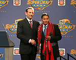 16 January 2004: Ramon Nunez (right) of Honduras and Southern Methodist University, with MLS Commissioner Don Garber (left), was taken by the Dallas Burn with the sixth overall pick of the draft. The Major League Soccer SuperDraft was held at the Charlotte Convention Center in Charlotte, NC as part of the annual National Soccer Coaches Association of America convention...