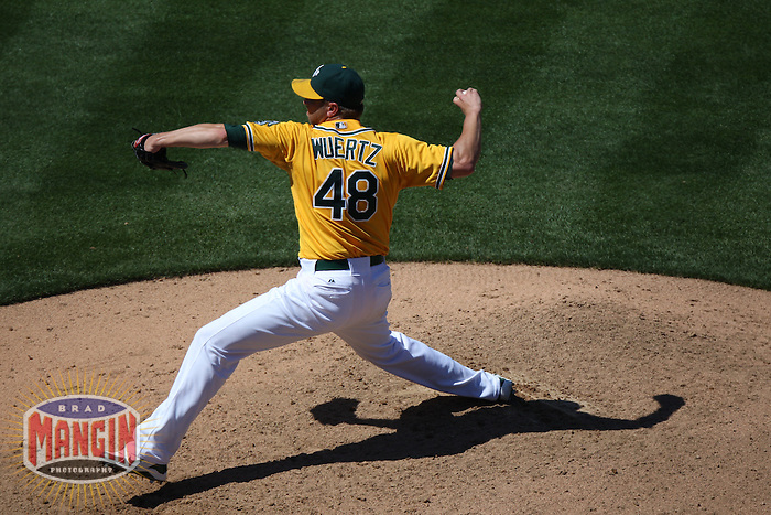 OAKLAND, CA - JULY 3:  Michael Wuertz #48 of the Oakland Athletics pitches against the Arizona Diamondbacks during the game at the Oakland-Alameda County Coliseum on July 3, 2011 in Oakland, California. Photo by Brad Mangin