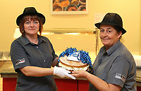 Pictured L-R: Lotto winners colleagues Andrea Davies and Clare Birchall holding a cake for them at Neath Port Talbot hospital. Wednesday 08 November 2017<br />