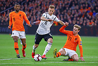 Joshua Kimmich (Deutschland Germany) gegen Frenkie de Jong (Niederlande) und Georginio Wijnaldum (Niederlande) - 24.03.2019: Niederlande vs. Deutschland, EM-Qualifikation, Amsterdam Arena, DISCLAIMER: DFB regulations prohibit any use of photographs as image sequences and/or quasi-video.