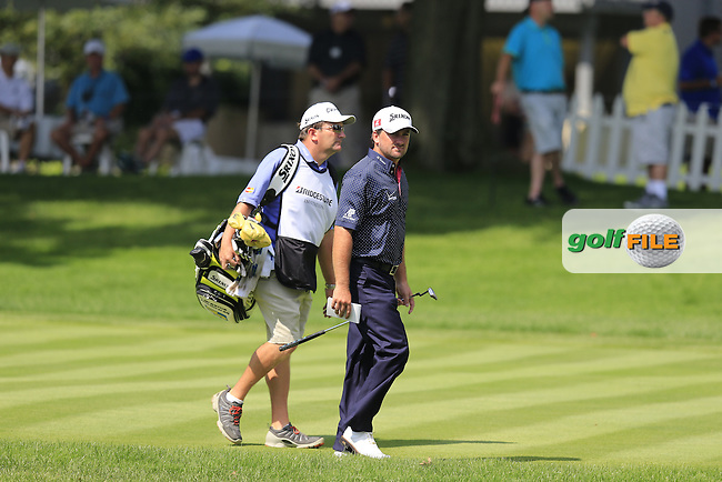 Graeme McDowell (NIR) and caddy Ken Comboy at the 16th green during Thursday's Round 1 of the 2013 Bridgestone Invitational WGC tournament held at the Firestone Country Club, Akron, Ohio. 1st August 2013.<br /> Picture: Eoin Clarke www.golffile.ie