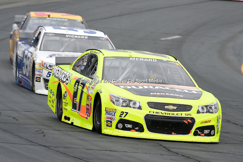 July 13, 2014 - Loudon, New Hampshire, U.S. - Sprint Cup Series driver Paul Menard (27) races in the NASCAR Sprint Cup Series Camping World RV 301 race held at the New Hampshire Motor Speedway in Loudon, New Hampshire. Eric Canha/CSM