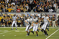 26 December 2010:  FIU Golden Panthers' special teams unit (pictured, FIU quarterback Wesley Carroll (13), kicker Jack Griffin (38), tight end Jonathan Faucher (30), tight end Joey Harris (86)) celebrate after Griffin kicked a 34-yard field goal as time expired to defeat the University of Toledo Rockets, 34-32, to win the 2010 Little Caesars Pizza Bowl at Ford Field in Detroit, Michigan.