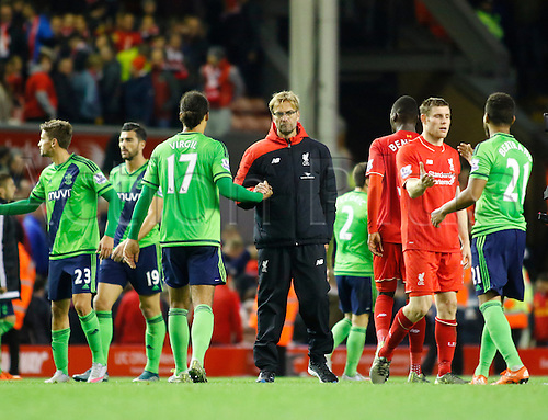 25.10.2015. Anfield, Liverpool, England. Barclays Premier League. Liverpool versus Southampton. Liverpool manager Jurgen Klopp comes onto the pitch at the end of the game and shakes hands with players on both sides.