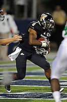 1 September 2011:  FIU running back Jeremiah Harden (6) carries the ball late in the game as the FIU Golden Panthers defeated the University of North Texas, 41-16, at FIU Stadium in Miami, Florida.