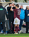 HEARTS' RUDI SKACEL GETS A HIGH FIVE FROM MANAGER PAULO SERGIO AS HE IS SUBSTITUTED