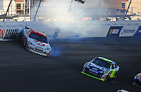 Mar 2, 2008; Las Vegas, NV, USA; NASCAR Sprint Cup Series driver Jeremy Mayfield (66) spins as Jimmie Johnson (48) drives below during the UAW Dodge 400 at Las Vegas Motor Speedway. Mandatory Credit: Mark J. Rebilas-US PRESSWIRE
