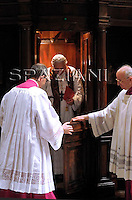 Pope Benedict XVI leaves a confessional in the St. Peter's Basilica, at the Vatican, Thursday, March 13, 2008