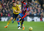 Crystal Palace's Cheikhou Kouyate is challenged by Arsenal's Granit Xhaka during the Premier League match at Selhurst Park, London. Picture date: 11th January 2020. Picture credit should read: Paul Terry/Sportimage