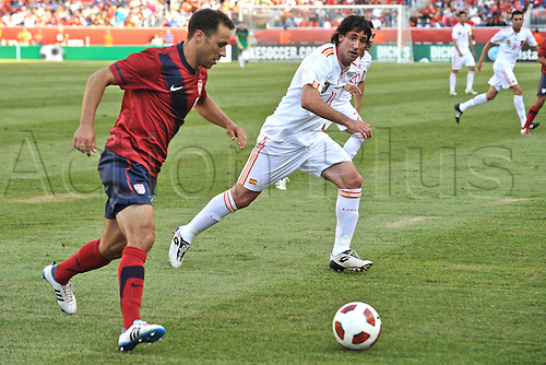 04.06.2011. Spain defender Joan Capdevila (11) tries to cut off United States defender Steve Cherundolo (6) as he comes up field with the ball during the Spain game against the USA at Gillette Stadium in Foxborough, MA