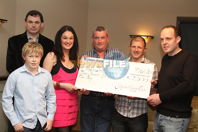 Geraldine Gallagher of Temple Street Childrens Hospital accepts a cheque from James Farrell, Joe Shevlin, Peter Kirwan, Niall Russell and Paul Newport in The Punt....(Photo credit should read Jenny Matthews www.newsfile.ie)....This Picture has been sent you under the conditions enclosed by:.Newsfile Ltd..The Studio,.Millmount Abbey,.Drogheda,.Co Meath..Ireland..Tel: +353(0)41-9871240.Fax: +353(0)41-9871260.GSM: +353(0)86-2500958.email: pictures@newsfile.ie.www.newsfile.ie.