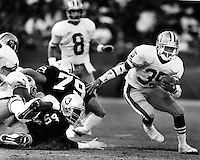 San Francisco 49ers Dexter Carter #35 runs against the Oakland Raiders. (1990 photo/Ron Riesterer)