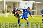 Tralee Dynamos Jeffery Roche and Limerick F.C.'s Michael Sheehan.