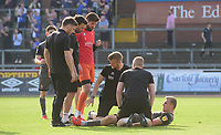 Lincoln City's Harry Anderson receives treatment for an injury from Lincoln City's head of sports science and medicine Mike Hine at the end of the game<br /> <br /> Photographer Chris Vaughan/CameraSport<br /> <br /> The EFL Sky Bet League Two - Carlisle United v Lincoln City - Friday 19th April 2019 - Brunton Park - Carlisle<br /> <br /> World Copyright © 2019 CameraSport. All rights reserved. 43 Linden Ave. Countesthorpe. Leicester. England. LE8 5PG - Tel: +44 (0) 116 277 4147 - admin@camerasport.com - www.camerasport.com