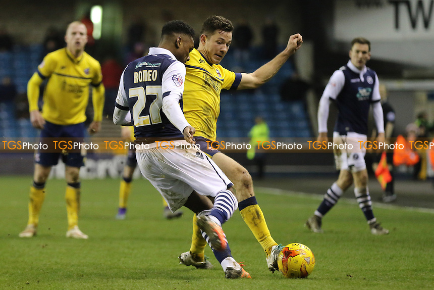 Mahlon Romeo of Millwall and Scunthorpe's Tom Hopper challenge for the ball during Millwall vs Scunthorpe United, Sky Bet League 1 Football at The Den
