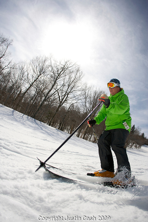 Skier enjoying the slopes of Mount Snow Resort in Dover, Vermont, 2009.  This image has a signed model release.