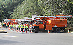 Asplundh Tree Service Trucks stage at the Monmouth Mall in Eatontown, New Jersey on Sunday September 4, 2016 in preparation for Tropical Storm Hermine.