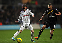 Pictured L-R: Joe Allen of Swansea against Kyle Walker of Tottenham Hotspur. Saturday 31 December 2011<br />