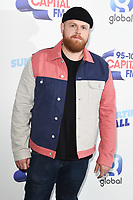 Tom Walker<br /> poses on the media line before performing at the Summertime Ball 2019 at Wembley Arena, London<br /> <br /> ©Ash Knotek  D3506  08/06/2019