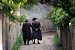 Two Ultra Orthodox men are seen walking in an alley in Jerusalem, March 15th, 2009. Photo By : Emil Salman / JINI