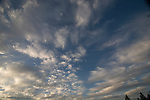 wide angle photograph by Paolo Diego Salcido of clouds in blue sky.