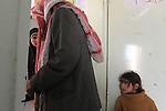 A man waits for a pharmacist to supply him with medicine from the 'Physicians for Human Rights' organization, in a school building in the village of Takuah, West Bank. The organization, comprised of Israeli, Palestinian and international physicians, arrived to the West Bank village to give medical treatment for locals, who are otherwise have difficulties to cross into Israel to get such treatment in advanced hospitals.