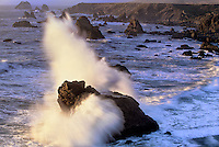 730850079 surf breaking over sea stacks along highway one on the pacific ocean at sonoma state beach california