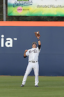 Clay Williamson #42 of the Cal State Fullerton Titans catchs a fly ball during a game against the Washington State Cougars at Goodwin Field on  February 15, 2014 in Fullerton, California. Washington State defeated Fullerton, 9-7. (Larry Goren/Four Seam Images)