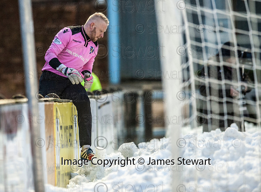 Stirling keeper Callum Reidford makes his way through the snow to retrieve the ball.